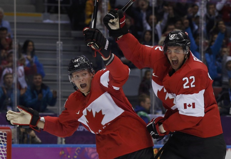 Canada's Jamie Benn (R) celebrates his goal against Team USA with teammate Corey Perry during the second period of the men's ice hockey semi-final game at the 2014 Sochi Winter Olympic Games, February 21, 2014. (REUTERS/Phil Noble)