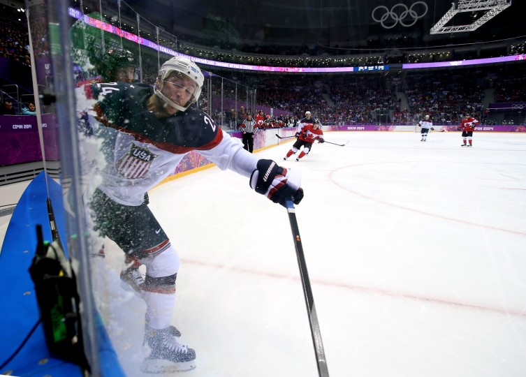 Ryan Callahan #24 of the United States reaches for the puck during the Men's Ice Hockey Semifinal Playoff against Canada on Day 14 of the 2014 Sochi Winter Olympics at Bolshoy Ice Dome on February 21, 2014 in Sochi, Russia. (Photo by Bruce Bennett/Getty Images)