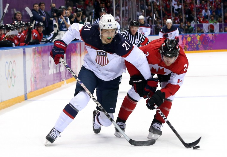 James van Riemsdyk #21 of the United States challenges Duncan Keith #2 of Canada for the puck during the Men's Ice Hockey Semifinal Playoff on Day 14 of the 2014 Sochi Winter Olympics at Bolshoy Ice Dome on February 21, 2014 in Sochi, Russia. (Photo by Bruce Bennett/Getty Images)