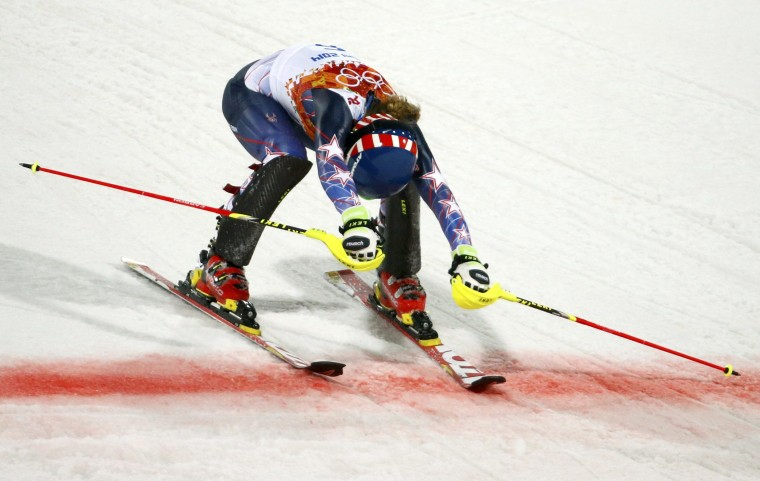 Mikaela Shiffrin of the U.S. reacts as she crosses the finishing line to end in first place during the second run of the women's alpine skiing slalom event at the 2014 Sochi Winter Olympics at the Rosa Khutor Alpine Centre, February 21, 2014. (REUTERS/Leonhard Foeger)