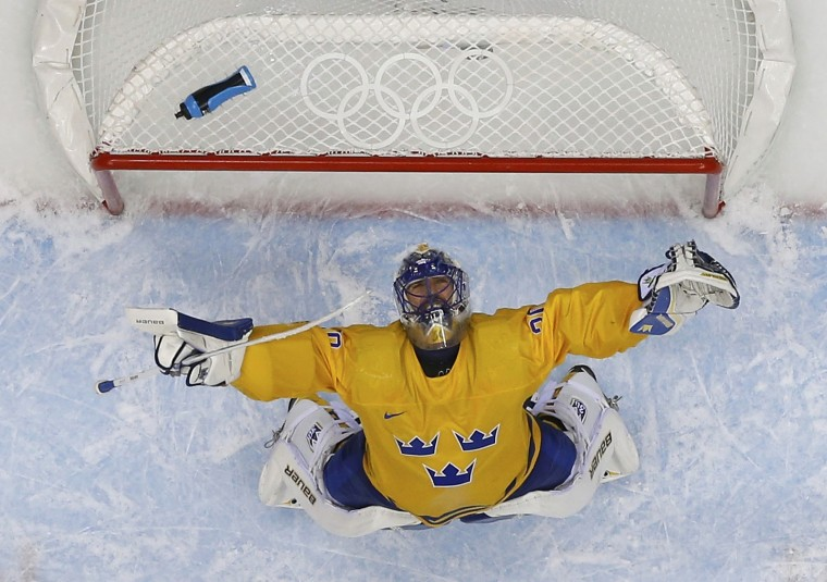 Sweden's goalie Henrik Lundqvist celebrates after defeating Finland in their men's play-off semi-final ice hockey game at the Sochi 2014 Winter Olympic Games, February 21, 2014. (REUTERS/Mark Blinch)