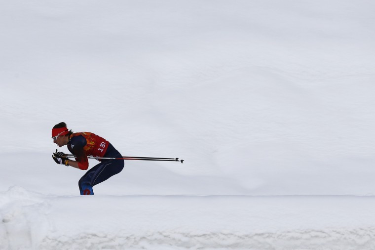 Russia's Maxim Vylegzhanin skis during the men's cross-country team sprint classic final at the Sochi 2014 Winter Olympics February 19, 2014. (REUTERS/Michael Dalder)
