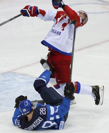 Finland's Lauri Korpikoski (bottom) hits Russia's Alexei Yemelin during the second period of their men's quarter-finals ice hockey game at the 2014 Sochi Winter Olympic Games, February 19, 2014. (REUTERS/Grigory Dukor)