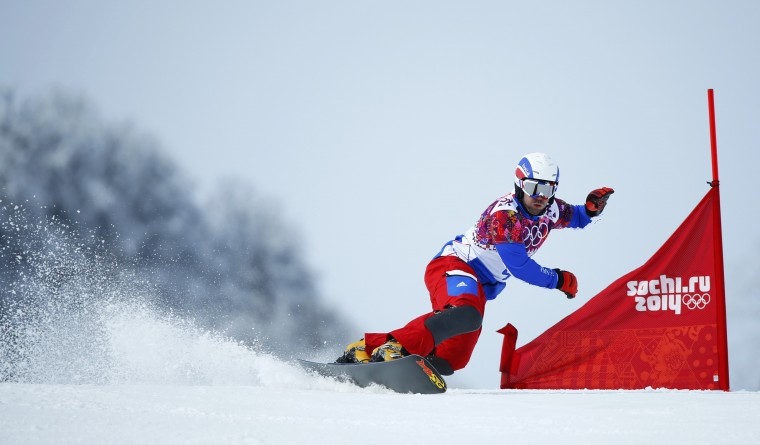 France's Sylvain Dufour competes during the men's snowboard parallel giant slalom qualification run at the 2014 Sochi Winter Olympic Games in Rosa Khutor February 19, 2014. (REUTERS/Mike Blake)