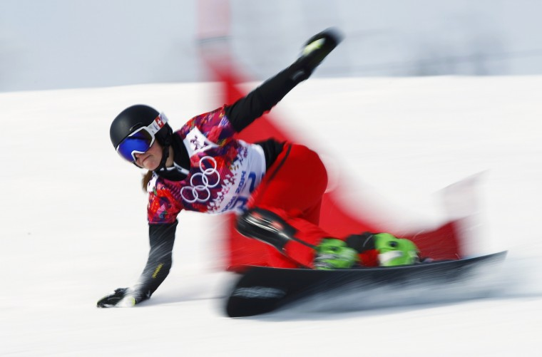 Switzerland's Ladina Jenny competes during the women's snowboard parallel giant slalom qualification run at the 2014 Sochi Winter Olympic Games in Rosa Khutor February 19, 2014. (