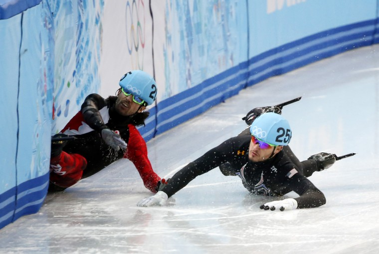 Charles Hamelin (CAN, 205) falls and takes out Eduardo Alvarez (USA, 256) in the mens' short track speedskating 1000m quarterfinals during the Sochi 2014 Olympic Winter Games at Iceberg Skating Palace. (Jeff Swinger-USA TODAY Sports)