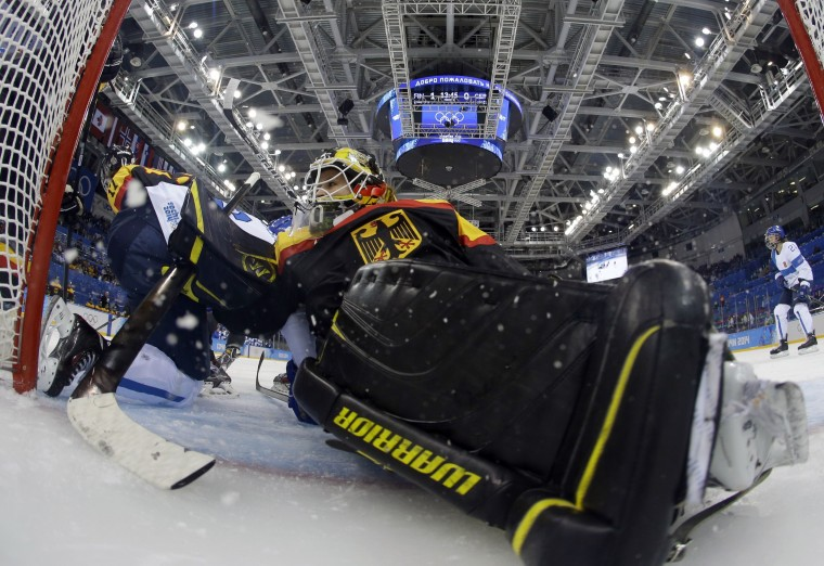 Germany's goalkeeper Jennifer Harss falls in the net during the Women's Ice Hockey 5th- 8th place classifications match between Finland and Germany at the Shayba Arena during the Sochi Winter Olympics on February 16, 2014. (Matt Soclum/AFP/Getty Images)
