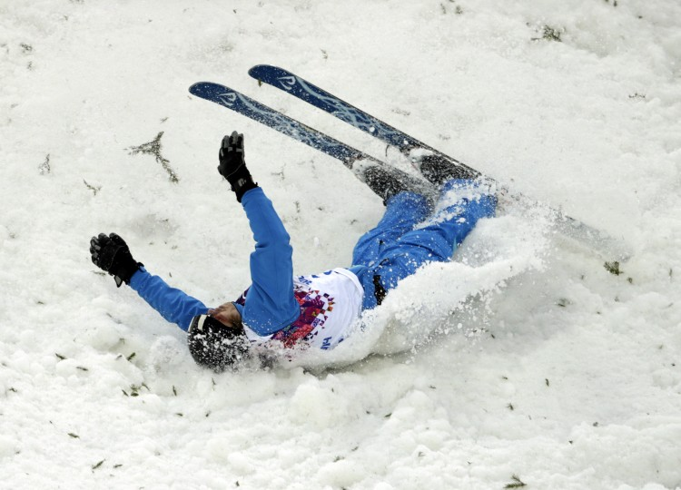 Denis Osipau (BLR) falls on his jump in men's freestyle skiing aerials during the Sochi 2014 Olympic Winter Games at Rosa Khutor Extreme Park. (Andrew P. Scott-USA TODAY Sports)