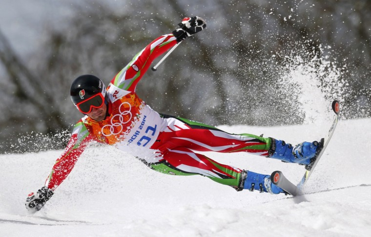 Portugal's Arthur Hanse crashes during the first run of the men's alpine skiing giant slalom event at the 2014 Sochi Winter Olympics at the Rosa Khutor Alpine Center February 19, 2014. REUTERS/Dominic Ebenbichler