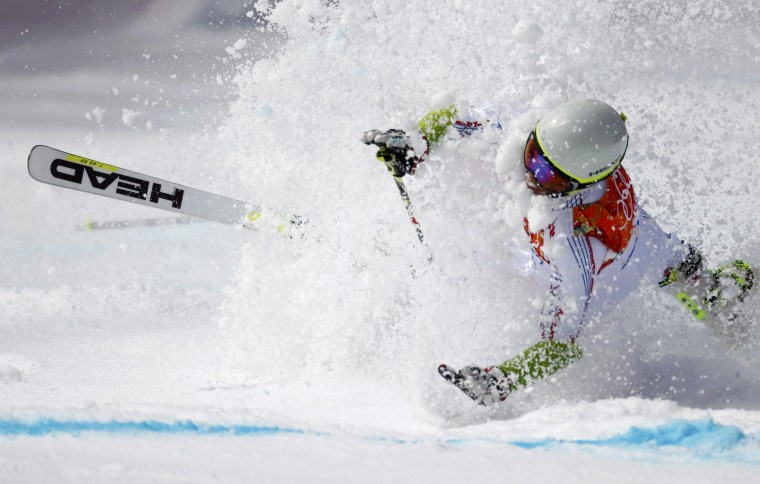 Andorra's Joan Verdu Sanchez crashes during the first run of the men's alpine skiing giant slalom event at the 2014 Sochi Winter Olympics at the Rosa Khutor Alpine Center February 19, 2014. REUTERS/Dominic Ebenbichler
