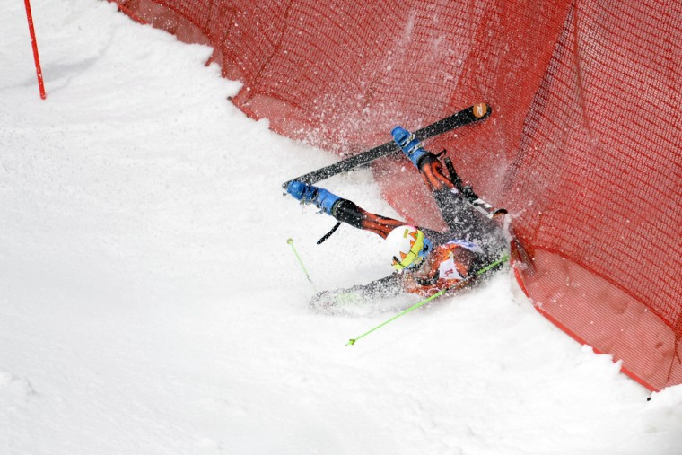 Alex Puente Tasias (ESP) crashes on his first run in the giant slalom during the Sochi 2014 Olympic Winter Games at Rosa Khutor Alpine Center. (Eric Bolte-USA TODAY Sports)