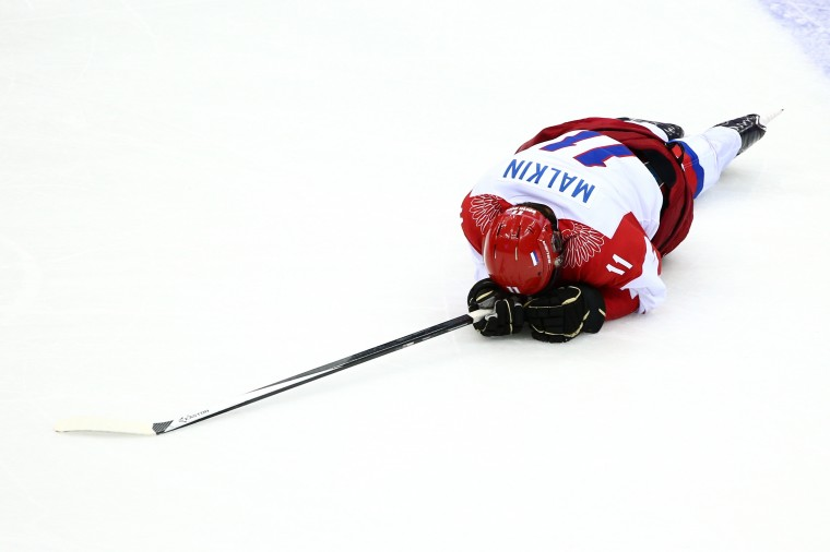 Yevgeni Malkin #11 of Russia falls to the ice after colliding with Mikael Granlund #64 of Finland during the Men's Ice Hockey Quarterfinal Playoff on Day 12 of the 2014 Sochi Winter Olympics at Bolshoy Ice Dome on February 19, 2014 in Sochi, Russia. (Photo by Clive Mason/Getty Images)