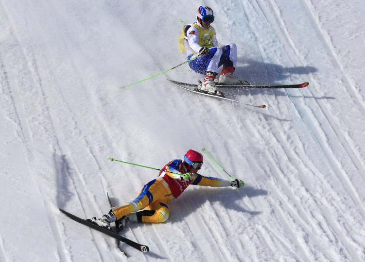 Sweden's Victor Oehling Norberg and Russia's Egor Korotkov crash in the Men's Freestyle Skiing Ski Cross Quarterfinals at the Rosa Khutor Extreme Park during the Sochi Winter Olympics on February 20, 2014. (Alexander Klein/AFP/Getty Images)