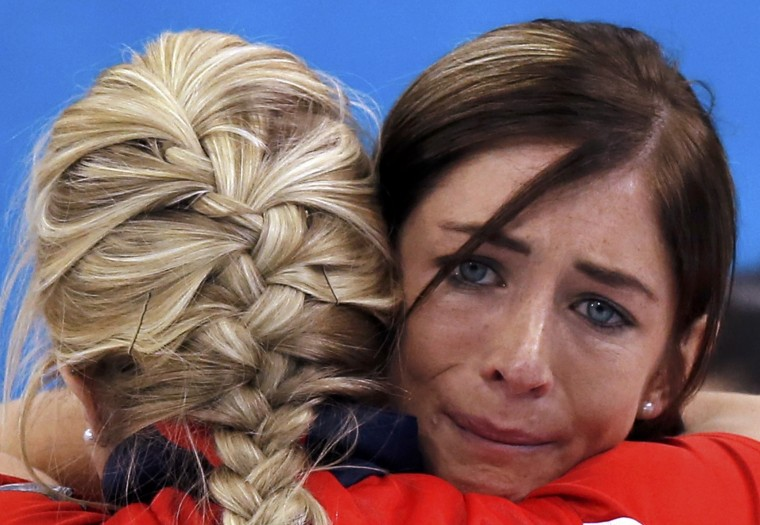 Britain's skip Eve Muirhead (facing camera) hugs vice Anna Sloan after winning their women's curling bronze medal game against Switzerland at the 2014 Sochi Winter Olympics in the Ice Cube Curling Center in Sochi February 20, 2014. (REUTERS/Phil Noble)
