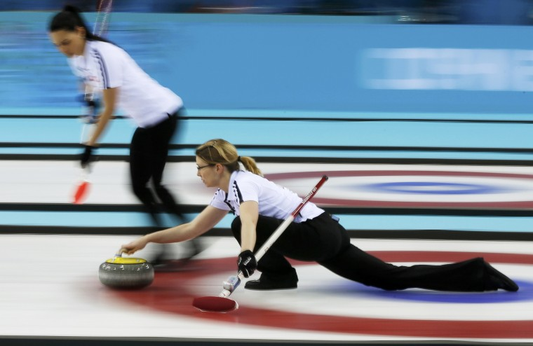 Switzerland's vice Carmen Schaefer (L) prepares to sweep as lead Janine Greiner delivers a stone in their women's bronze medal curling game against Britain at the Ice Cube Curling Centre during the Sochi 2014 Winter Olympics February 20, 2014. (REUTERS/Phil Noble)