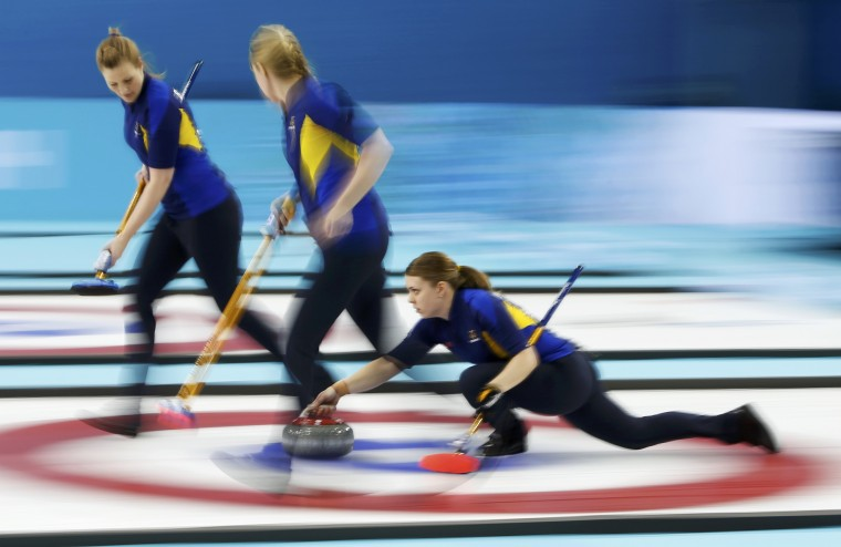 Sweden's second Maria Wennerstroem (R) delivers a stone in their women's gold medal curling game against Canada at the Ice Cube Curling Centre during the Sochi 2014 Winter Olympics February 20, 2014. (REUTERS/Marko Djurica)