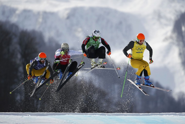 Germany's Florian Eigler, Slovenia's Filip Flisar, Norway's Didrik Bastian Juell and Germany's Andreas Schauer compete during the men's freestyle skiing skicross quarter-finals at the 2014 Sochi Winter Olympic Games in Rosa Khutor February 20, 2014. (REUTERS/Dominic Ebenbichler)