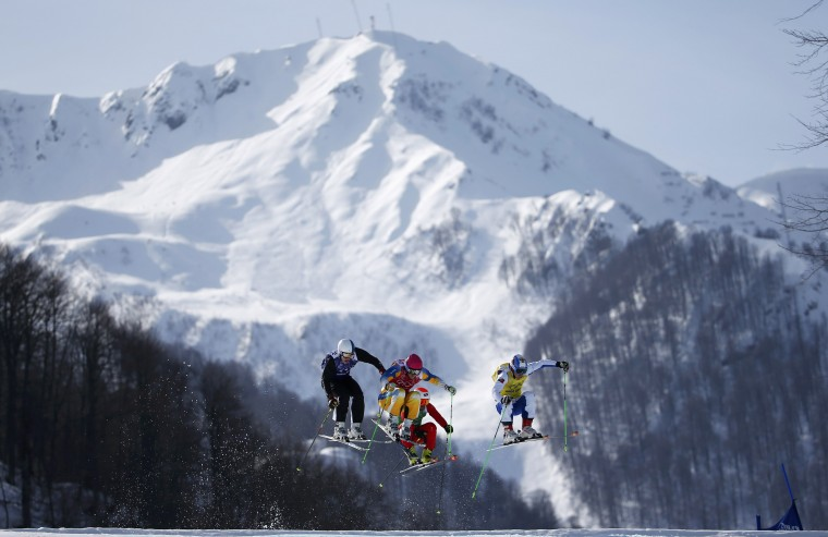 Finland's Jouni Pellinen, Sweden's Victor Oehling-Norberg, Switzerland's Armin Niederer and Russia's Egor Korotkov during the men's freestyle skiing skicross quarter-finals at the 2014 Sochi Winter Olympic Games in Rosa Khutor February 20, 2014. (REUTERS/Dominic Ebenbichler)