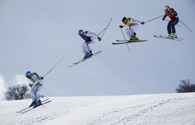 France's Jean Frederic Chapuis competes with compatriots Arnaud Bovolenta and Jonathan Midol and Canada's Brady Leman during the men's freestyle skiing skicross finals round at the 2014 Sochi Winter Olympic Games in Rosa Khutor February 20, 2014. (REUTERS/Dominic Ebenbichler)