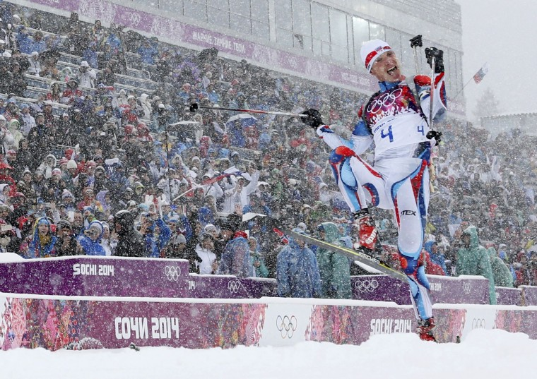 Czech Republic's Ondrej Moravec celebrates after crossing the finsihs line during the men's biathlon 15 km mass start event at the 2014 Sochi Winter Olympics February 18, 2014. Norway's Emil Hegle Svendsen finished first ahead of France's Martin Fourcade and Moravec. (REUTERS/Carlos Barria)