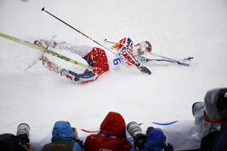 Norway's Joergen Graabak celebrates after finishing first in the cross country race of the Nordic Combined individual Gundersen 10 km event of the Sochi 2014 Winter Olympic Games, at the RusSki Gorki Ski Jumping Center in Rosa Khutor, February 18, 2014. (REUTERS/Kai Pfaffenbach)