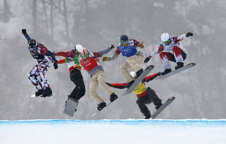 From L-R: Russia's Nikolay Olyunin, Spain's Lucas Eguibar , Trevor Jacob of the U.S., Alex Deibold of the U.S., Norway's Stian Sivertzen and Canada's Kevin Hill compete during the men's snowboard semi-final at the 2014 Sochi Winter Olympic Games in Rosa Khutor February 18, 2014. (REUTERS/Mike Segar)