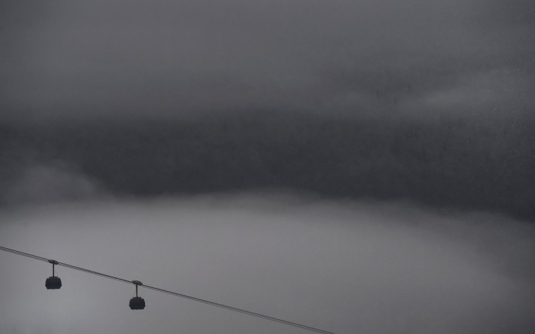 Gondolas are seeing amidst the fog ahead of the men's freestyle skiing halfpipe competition at the 2014 Sochi Winter Olympic Games in Rosa Khutor February 18, 2014. (REUTERS/Dylan Martinez)