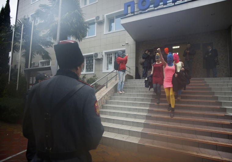 Masked members of Pussy Riot leave a police station in Adler during the 2014 Sochi Winter Olympics, February 18, 2014. Pussy?Riot?protest band members Maria Alyokhina and Nadezhda Tolokonnikova?were released from police custody on Tuesday, Tolokonnikova's husband said hours after they were detained in Sochi, where?Russia is holding the 2014 Winter Olympics. (REUTERS/Eric Gaillard)