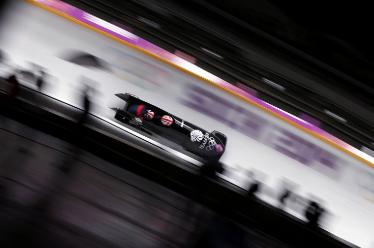 Britain's pilot Paula Walker and Rebekah Wilson speed down the track during the women's bobsleigh competition at the 2014 Sochi Winter Olympics February 18, 2014. REUTERS/Arnd Wiegmann