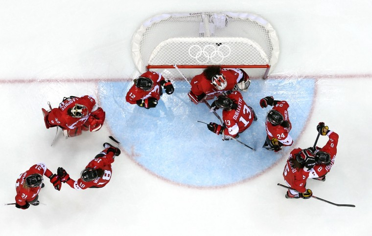 Canada huddles around the net before the game against the United States during the Ice Hockey Women's Gold Medal Game on day 13 of the Sochi 2014 Winter Olympics at Bolshoy Ice Dome on February 20, 2014 in Sochi, Russia. (Photo by Martin Rose/Getty Images)