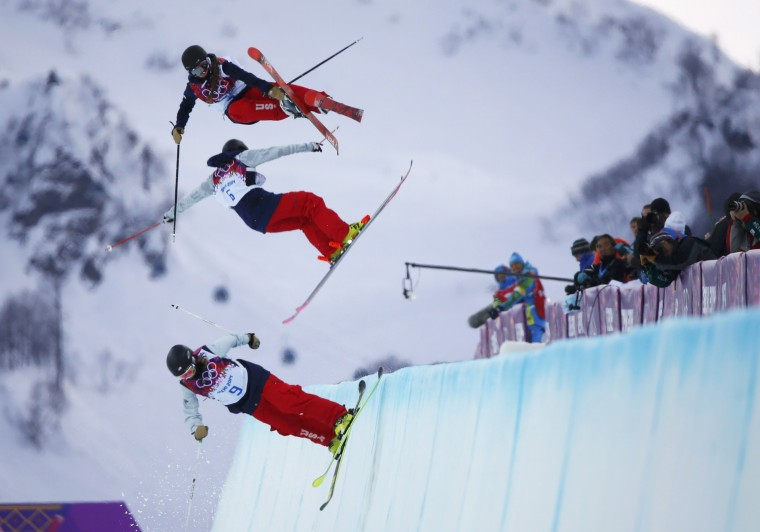 Annalisa Drew, Brita Sigourney (C) and Maddie Bowman of the U.S. (top) practice during warm sessions ahead of the women's freestyle skiing halfpipe qualification round at the 2014 Sochi Winter Olympic Games in Rosa Khutor February 20, 2014. (REUTERS/Mike Blake)
