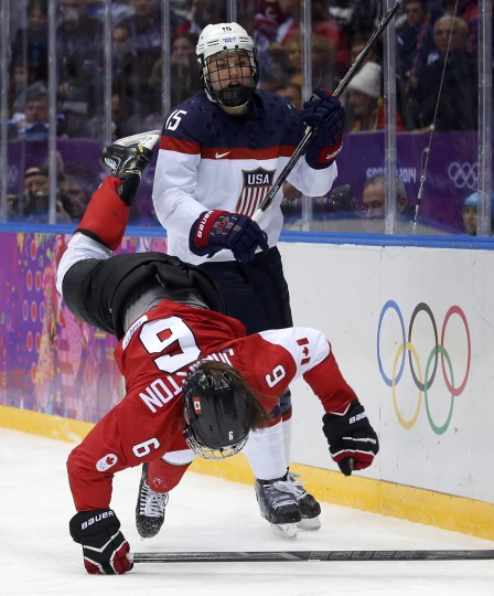 Canada's Rebecca Johnston (6) is checked by Team USA's Anne Schleper during the second period of the women's ice hockey gold medal game at the 2014 Sochi Winter Olympic Games, February 20, 2014. (REUTERS/Grigory Dukor)
