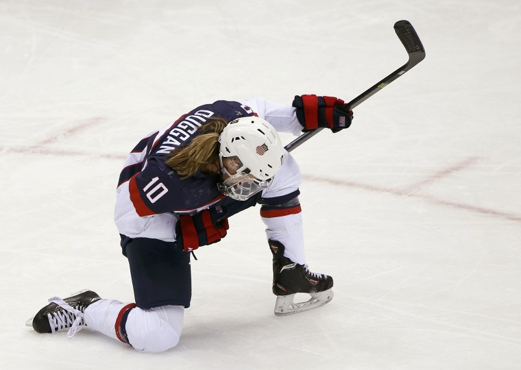 Team USA's Meghan Duggan celebrates after scoring on Canada during the second period of their women's ice hockey gold medal game at the Sochi 2014 Winter Olympic Games February 20, 2014. (REUTERS/Jim Young)