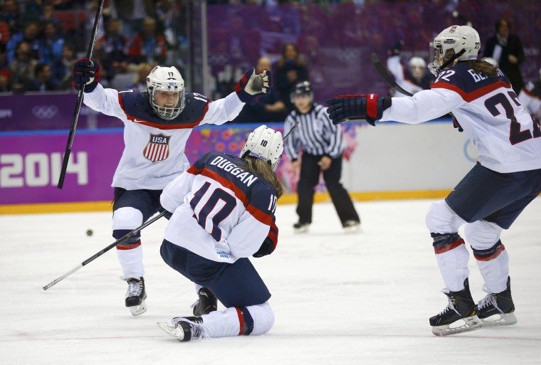 Team USA's Meghan Duggan (C) celebrates her goal against Canada with teammates Jocelyne Lamoureux (L) and Kacey Bellamy during the second period of the women's ice hockey gold medal game at the 2014 Sochi Winter Olympic Games, February 20, 2014. (REUTERS/Brian Snyder