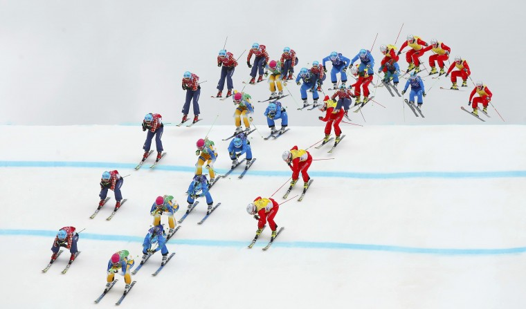 Sweden's Anna Holmlund (green bib), Canada's Kelsey Serwa (red bib), Austria's Katrin Ofner (blue bib) and Switzerland's Fanny Smith (yellow bib) competes during the women's freestyle skiing skicross semi-finals at the 2014 Sochi Winter Olympic Games in Rosa Khutor February 21, 2014. Picture taken with multiple exposure function. (REUTERS/Lucas Jackson)