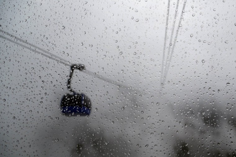 Raindrops are seen on a gondola's window on a foggy day near the Rosa Khutor alpine resort close to Sochi February 21, 2014. (REUTERS/Stefan Wermuth)