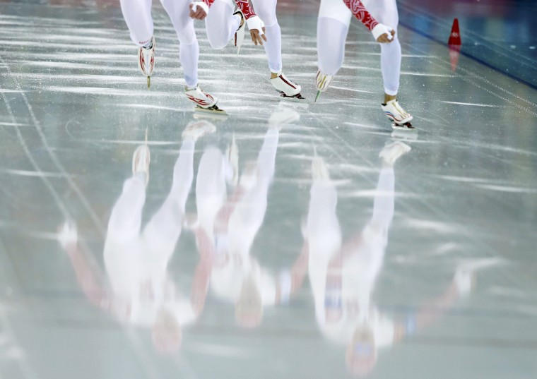 Russia's skaters start during their men's speed skating team pursuit quarter-finals event at the Adler Arena in the Sochi 2014 Winter Olympic Games February 21, 2014. (REUTERS/Phil Noble)