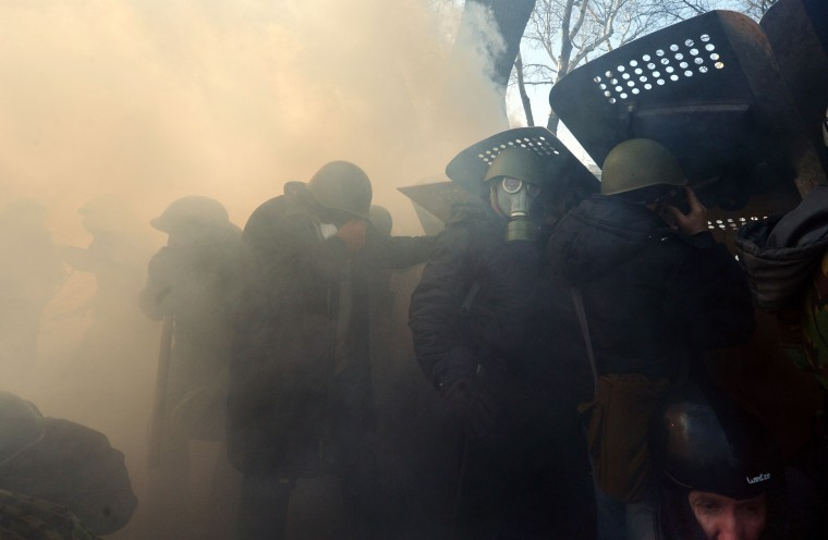 Anti-government protetsers clash with police in front of the Ukrainian Parliament in Kiev on February 18, 2014. Police on Tuesday fired rubber bullets at stone-throwing protesters as they demonstrated close to Ukraine's parliament in Kiev, an AFP reporter at the scene said. Police also responded with smoke bombs after protesters hurled paving stones at them as they sought to get closer to the heavily-fortified parliament building. (Sergei Supinsky/AFP/Getty Images)