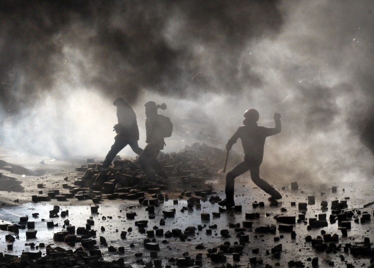Anti-government protesters clash with police in Kiev on February 18, 2014. Police on Tuesday fired rubber bullets at stone-throwing protesters as they demonstrated close to Ukraine's parliament in Kiev, an AFP reporter at the scene said. Police also responded with smoke bombs after protesters hurled paving stones at them as they sought to get closer to the heavily-fortified parliament building. (Antatolii Stephanov/AFP/Getty Images)