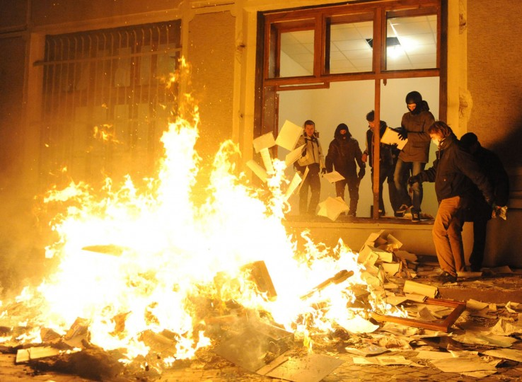Anti-government protesters burn documents in the main Police City Office in the western Ukrainian city of Lviv on February 18, 2014. Anti-government protesters in the western Ukrainian city of Lviv on February 18 seized the regional administration building and police headquarters as clashes raged in Kiev, an AFP correspondent at the scene said. Some 500 demonstrators stormed the regional administration after bombarding it with stones before taking the control of the local police headquarters in the largely pro-EU city. (Yuriu Dyachyshyn/AFP/Getty Images)