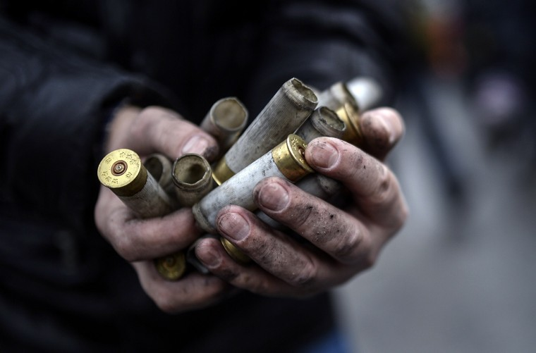 An anti-government protester shows empty bullet casings used by riot police against demonstrators in central Kiev on February 20, 2014. At least 25 protesters were killed on February 20 in fresh clashes between thousands of demonstrators and heavily-armed riot police in the heart of Kiev, AFP correspondents at the scene said. The bodies of eight demonstrators were lying outside Kiev's main post office on Independence Square, an AFP reporter said. The bodies of 17 other demonstrators with apparent gunshot wounds were also seen in the vicinity of two hotels on opposite sides of the protest encampment. (Sergei Supinky/AFP/Getty Images)