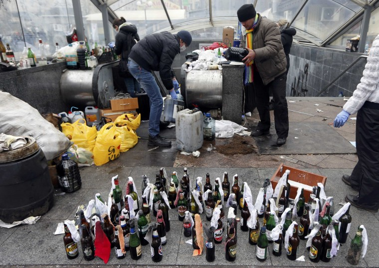 Anti-government protesters prepare Molotov cocktails during clashes with riot police in the Independence Square in Kiev February 20, 2014. Fresh fighting broke out in central Kiev on Thursday, shattering a truce declared by Ukrainian President Viktor Yanukovich, as the Russian-backed leader met European ministers demanding he compromise with pro-EU opponents. (REUTERS/Vasily Fedosenko)