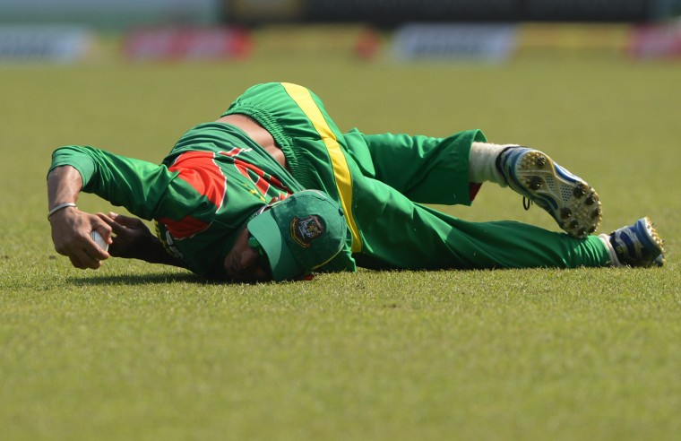 Bangladesh cricketer Nasir Hossain tries to catch the ball during the second One-Day International (ODI) cricket match between Bangladesh and Sri Lanka at the Sher-e-Bangla National Cricket Stadium in Dhaka on February 20, 2014. (Munir uz Zaman/AFP/Getty Images)