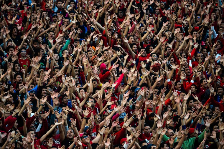 Egypt Al-Ahly fans chant slogans in support of their team ahead of their African Super cup final football match against Tunisia's Club Sportif Sfaxien in Cairo on February 20, 2014. (Mohamed El-Shahed/AFP/Getty Images)