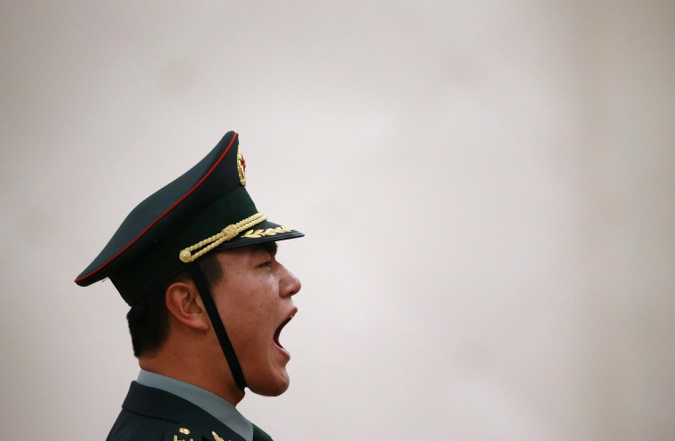 An honor guard commander shouts commands ahead of a welcome ceremony for Senegal's President Macky Sall at the Great Hall of the People in Beijing February 20, 2014. (REUTERS/Petar Kujundzic)