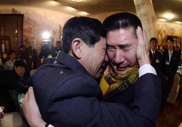South Korean Park Yang-gon (R), 53, and his North Korean brother Park Yang-su, who was abducted by North Korea, cry during their family reunion at the Mount Kumgang resort in North Korea, February 20, 2014. The six days of family reunions took place under the cloud of a U.N. report on human rights abuses in North Korea, which investigators have said were comparable to Nazi-era atrocities. A group of 100 South Koreans crossed the world's most heavily fortified border on Thursday morning, a frontier that separates two countries that remain at war after their conflict ended in an armistice rather than a peace treaty. (REUTERS/Korea Pool/News)