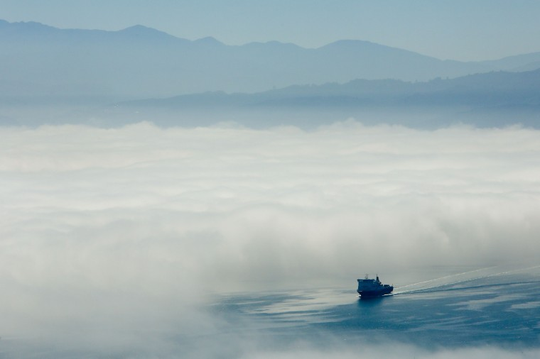 The Bluebridge ferry sails out of the fog on Wellington Harbour on February 20, 2014 in Wellington, New Zealand. The thick fog closed Wellington Airport, affecting travel plans for thousands of airline passengers around the country. (Photo by Hagen Hopkins/Getty Images)