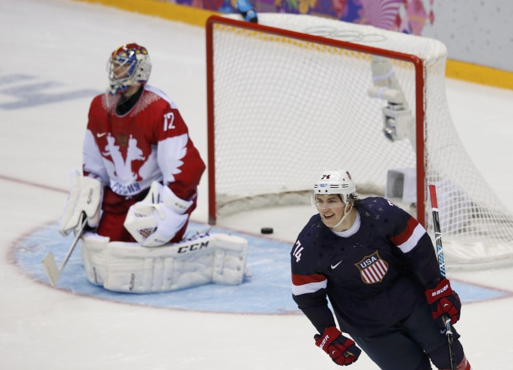Team USA's T.J. Oshie (R) reacts after scoring the game-winning shootout goal against Russia's goalie Sergei Bobrovski during their men's preliminary round ice hockey game at the 2014 Sochi Winter Olympics, February 15, 2014. REUTERS/Grigory Dukor