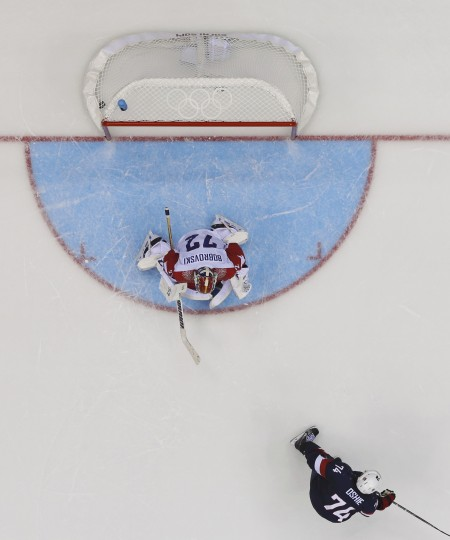 Team USA's T.J. Oshie scores the game winning shootout goal against Russia's goalie Sergei Bobrovski during their men's preliminary round ice hockey game at the Sochi 2014 Winter Olympic Games February 15, 2014. REUTERS/Mark Blinch