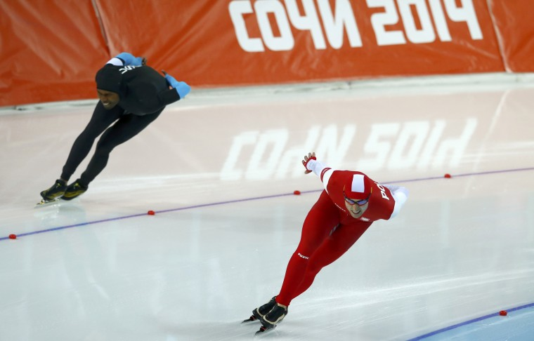 Zbigniew Brodka of Poland (R) and Shani Davis of the U.S. compete in the men's 1,500 metres speed skating race during the 2014 Sochi Winter Olympics, February 15, 2014. REUTERS/Marko Djurica